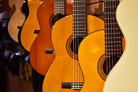 An array of hung acoustic guitars