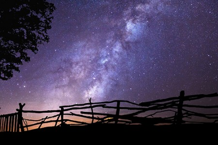 Wyoming night sky and wood rail fence