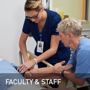 Nursing student and professor with patient