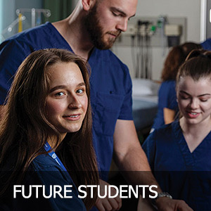 Female nursing student in forefront with male and female students in background