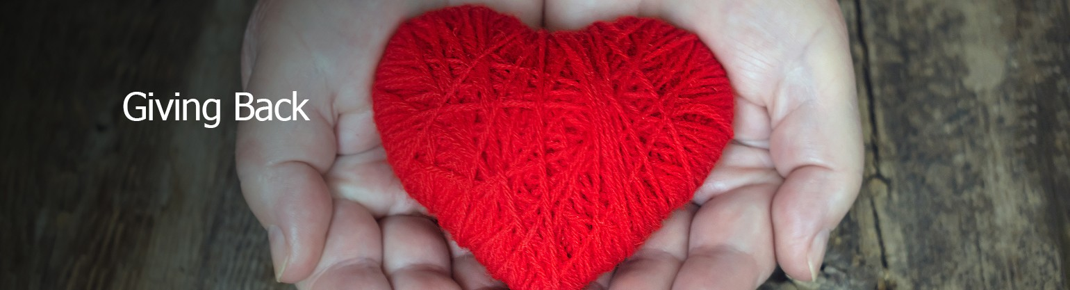 Hands holding a knitted heart