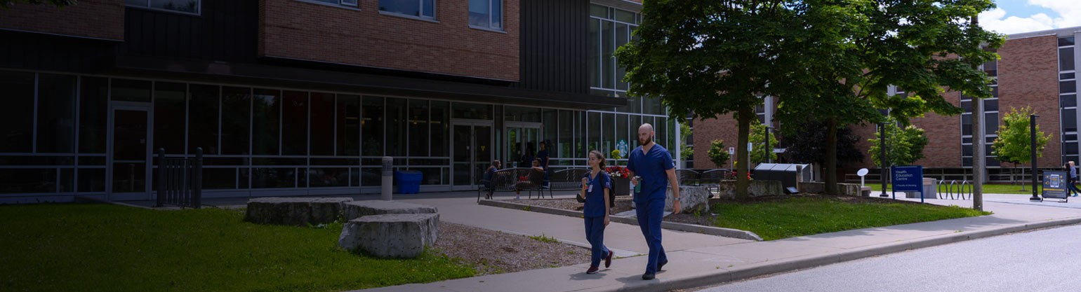 Nursing students walking past Anthony P. Toldo Health Education Centre
