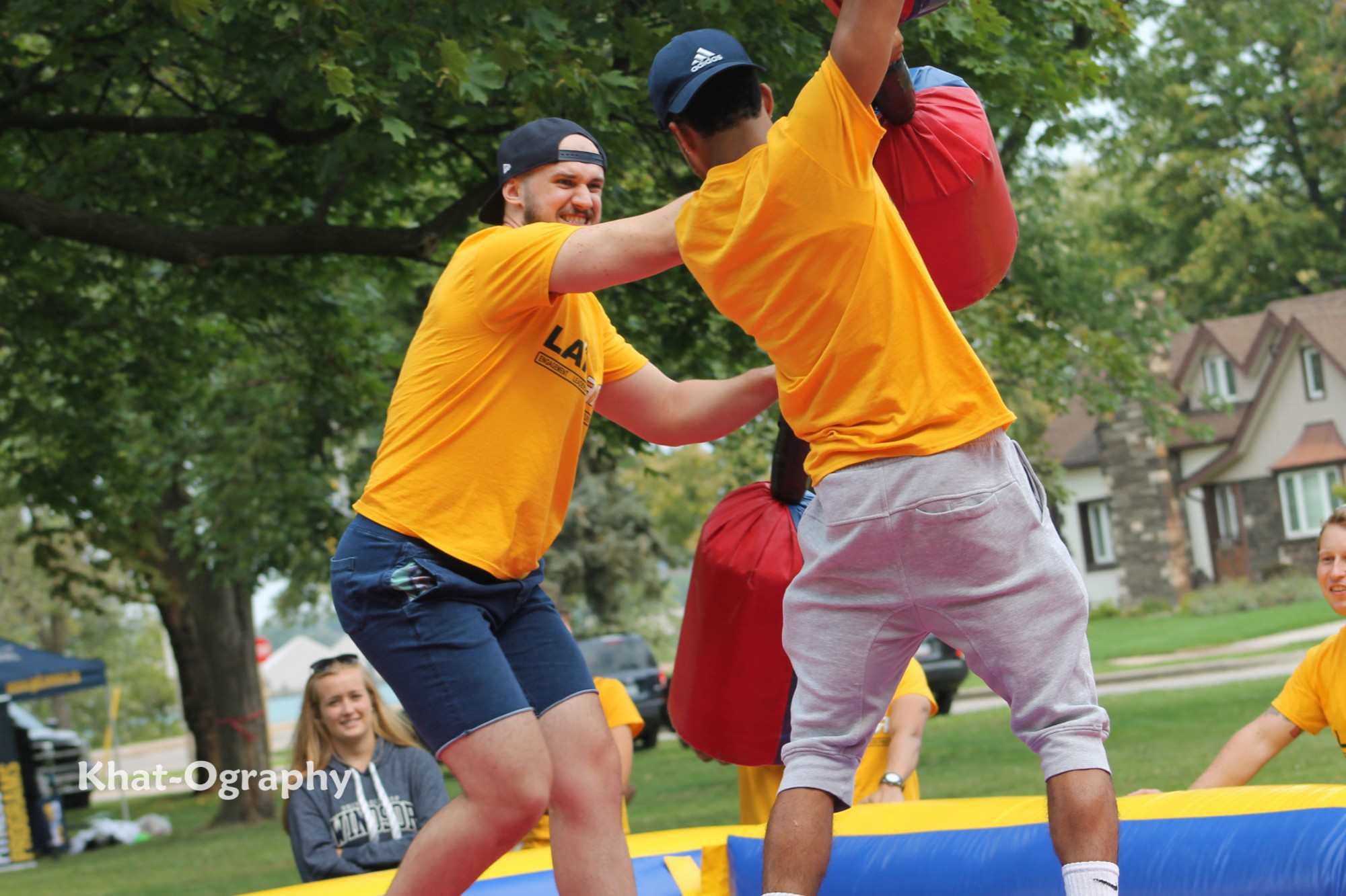Two students battle with foam sticks at Welcome Week.