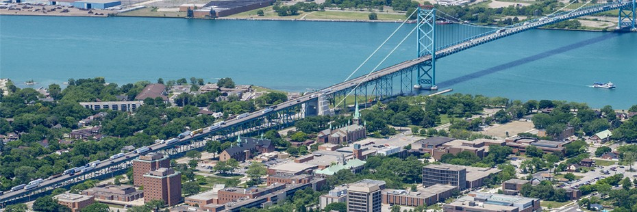 Aerial shot of the UWindsor Campus and the Ambassador Bridge