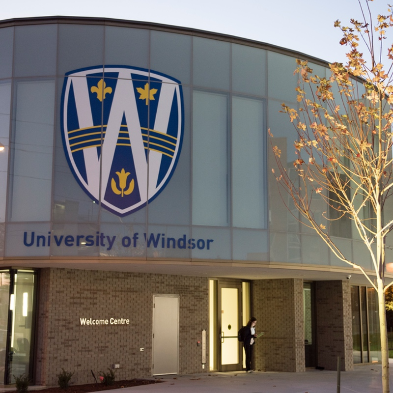 Photograph taken by a UWindsor employee of the Welcome Centre building at dusk