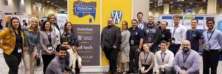 group image of University of Windsor Researchers and students at a trade show