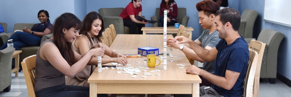 Four residence students playing game
