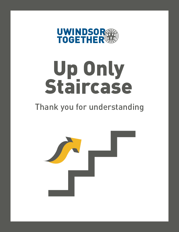 A sign is displayed advising which direction they should travel when traversing stairs or hallways.