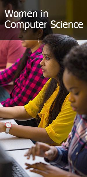 Females students at computer monitors