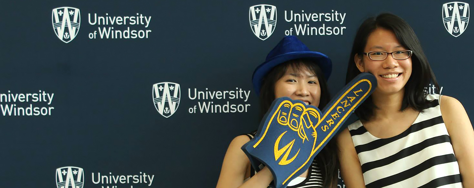 students pose in photo booth