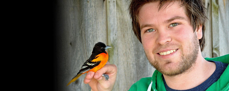 Matt Watson holding oriole