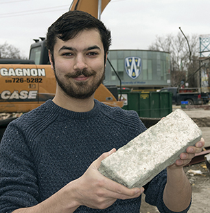 Mike holding brick
