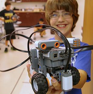 Child holding robot