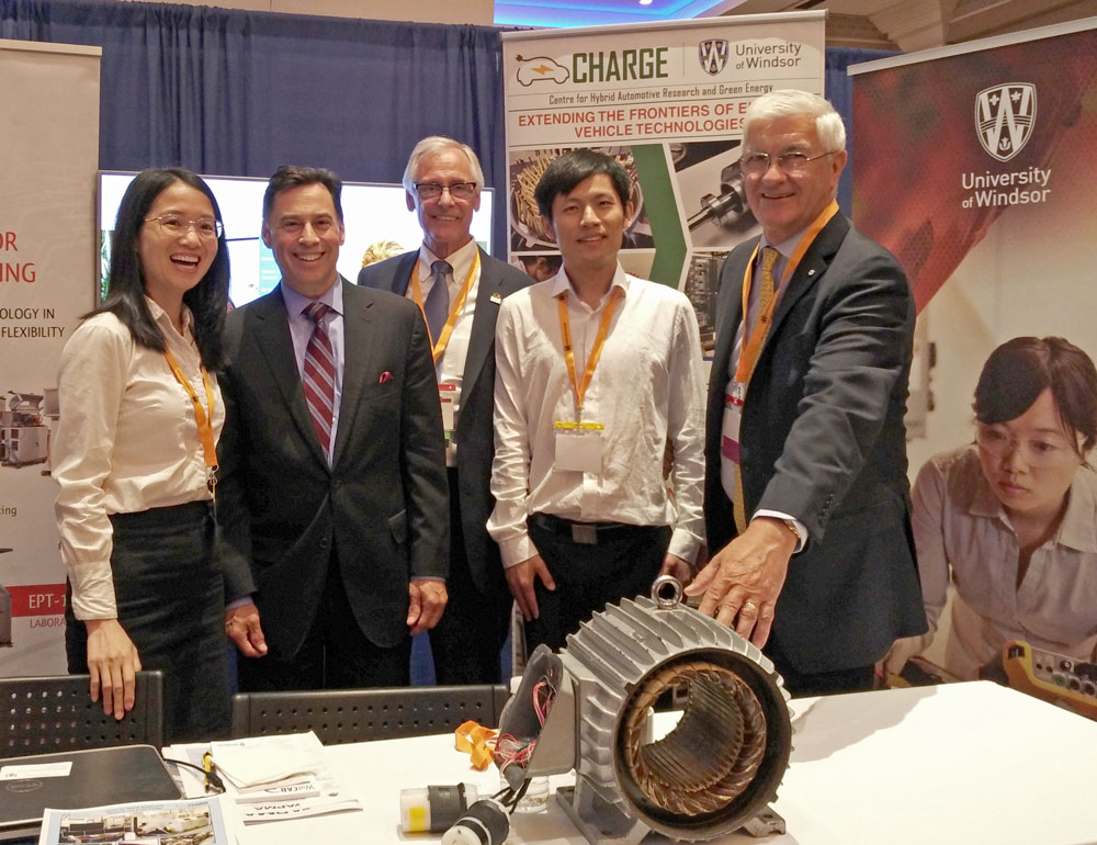 UWindsor researchers Chunyan Lai (left) and Guodong Feng (second from right) meet with Ontario economic development minister Brad Duguid, APMA chair Roy Verstraete, and government auto advisor Ray Tanguay at the association's conference on Wednesday, June 14.