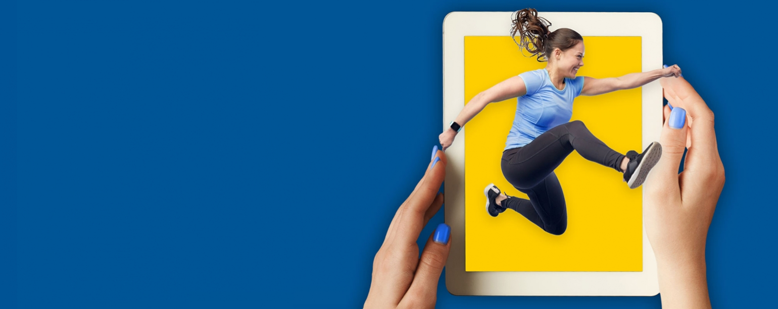 Woman jumping out of tablet computer