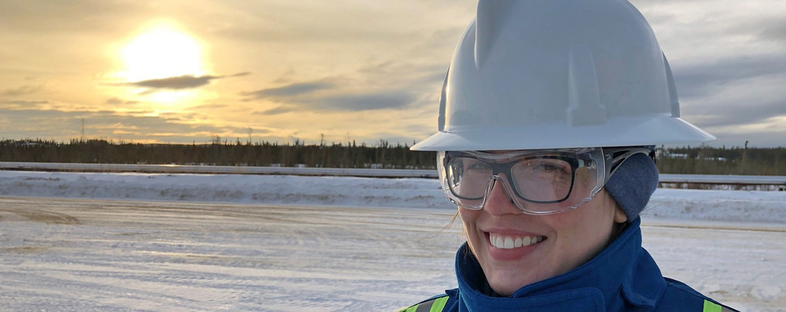 Karlynne Dominato wearing hardhat in oilfield