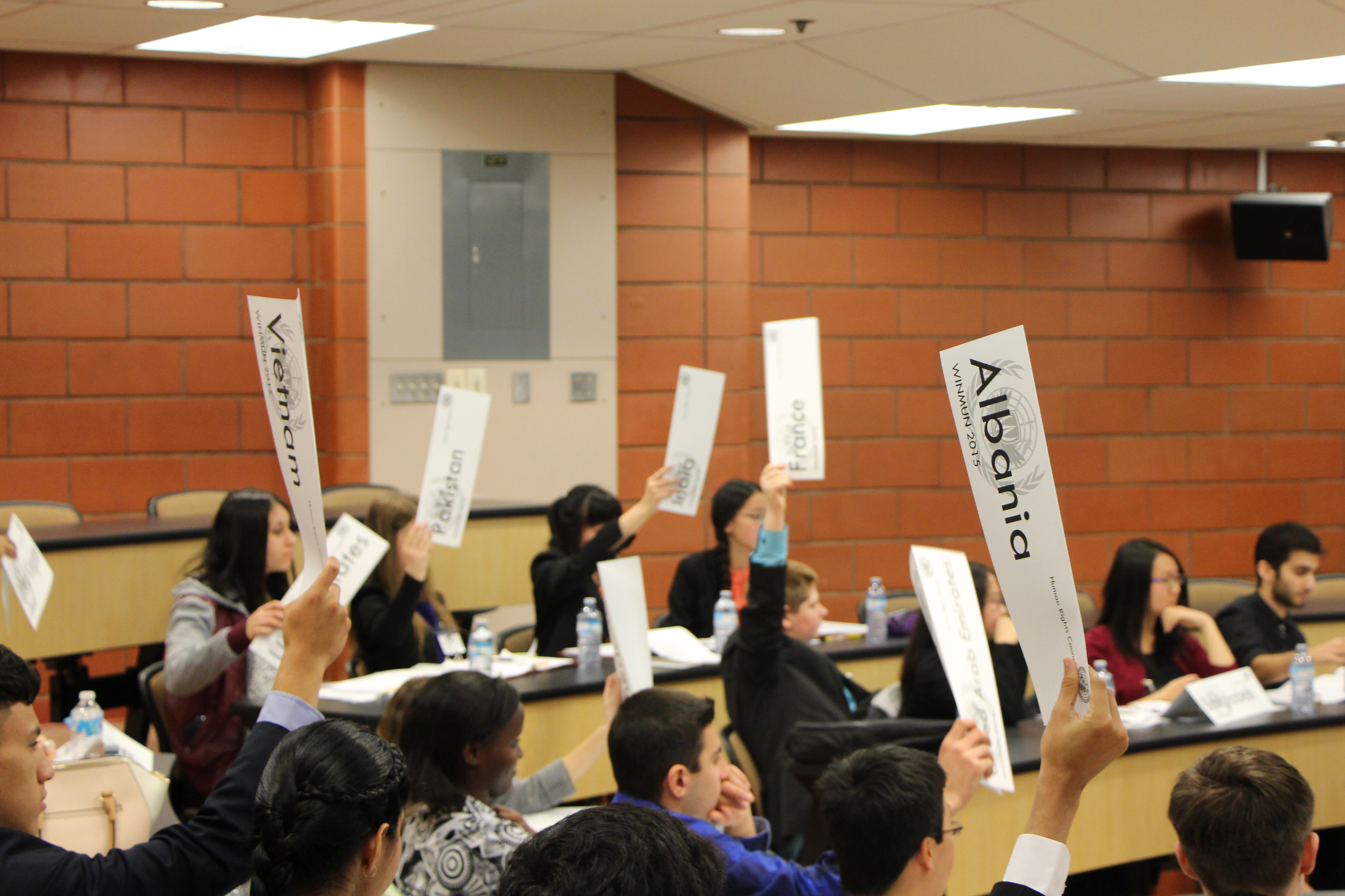Students engaged in debates on global issues during a model UN conference organized by the University of Windsor Model United Nations Club (WINMUN) and the Political Science department.