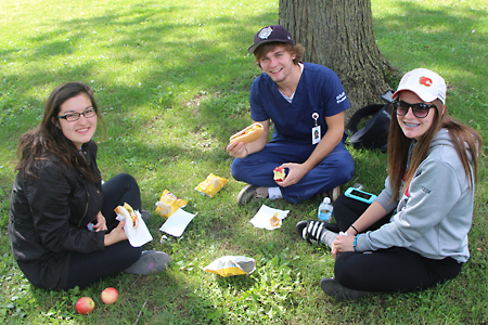 students picnic on lawn