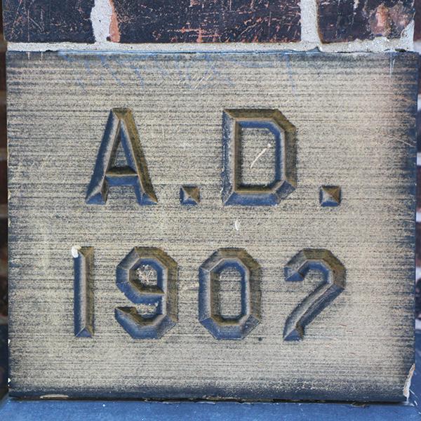 stone carving -- cornerstone AD 1902
