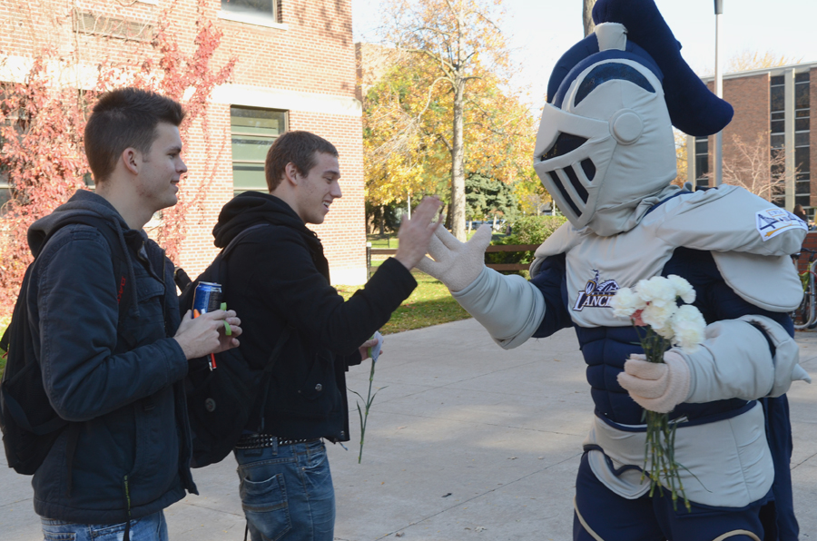 Two student high-five Winston