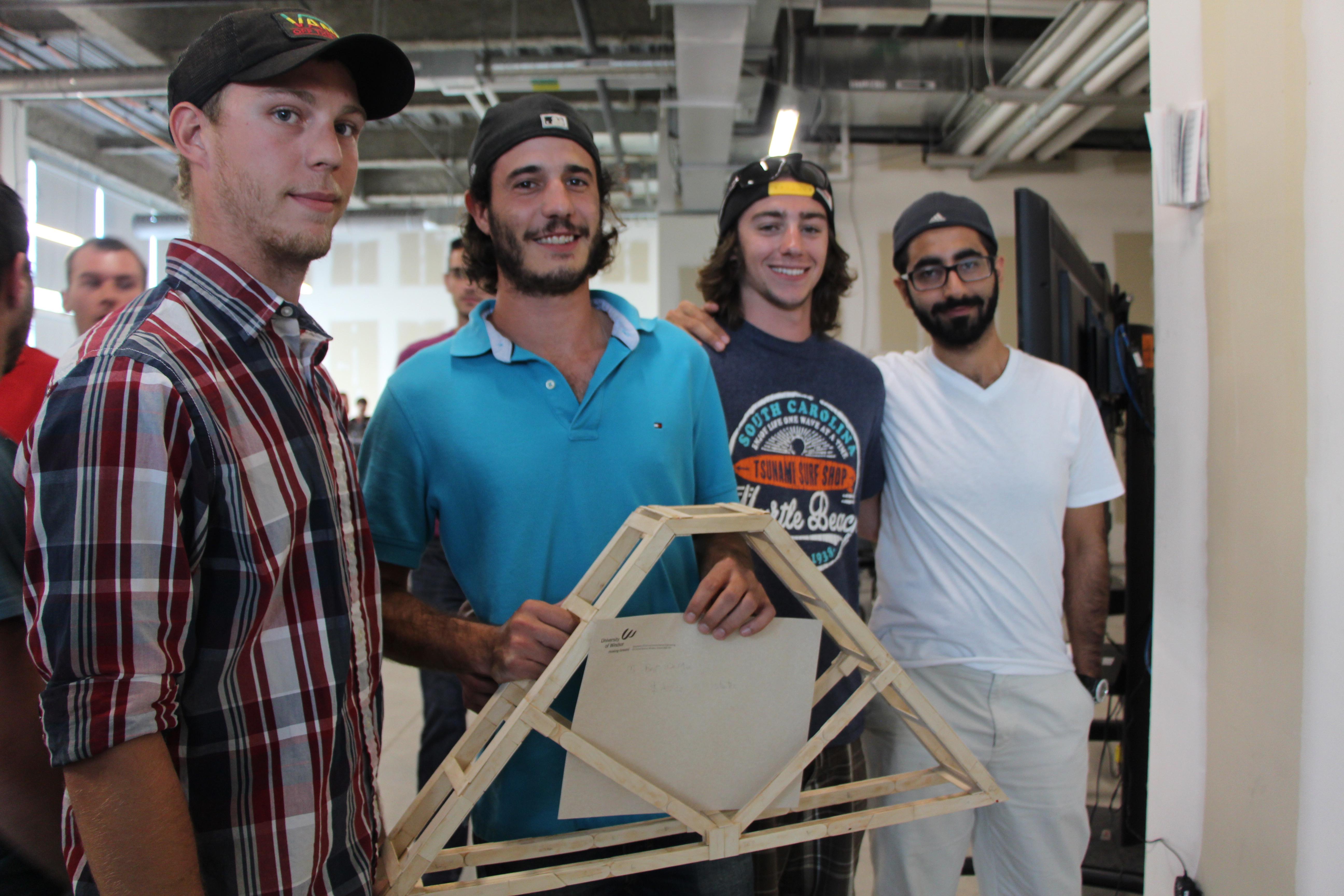 Third year civil engineering students Jordan Gangier, Griffin Cecilaws, Chris Mullin and Ali Taeb display their model bridge, a winner of the best performing bridge
