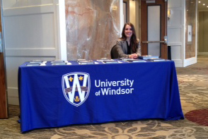 Students welcome guests to a reception for UWindsor applicants.
