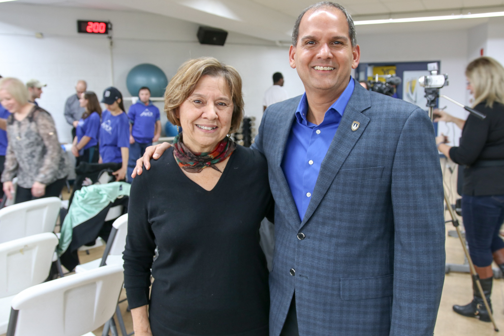 Nancy Wallace-Gero, Executive Director of Community Living Essex County and Michael Khan, Dean of the Faculty of Kinesiology, are pictured at the kickoff of Fit Together on Wednesday, Dec. 5, 2017.