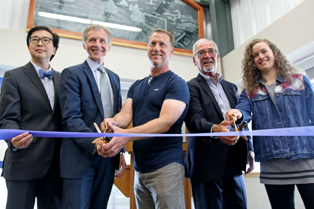 University of Windsor's Dr. Michael Siu, Dr. Alan Wildeman, Dr. Trevor Pitcher, LaSalle Mayor Ken Antaya and student Marlena McCabe cut the ribbon at the grand opening of the Freshwater Restoration Ecology Centre.