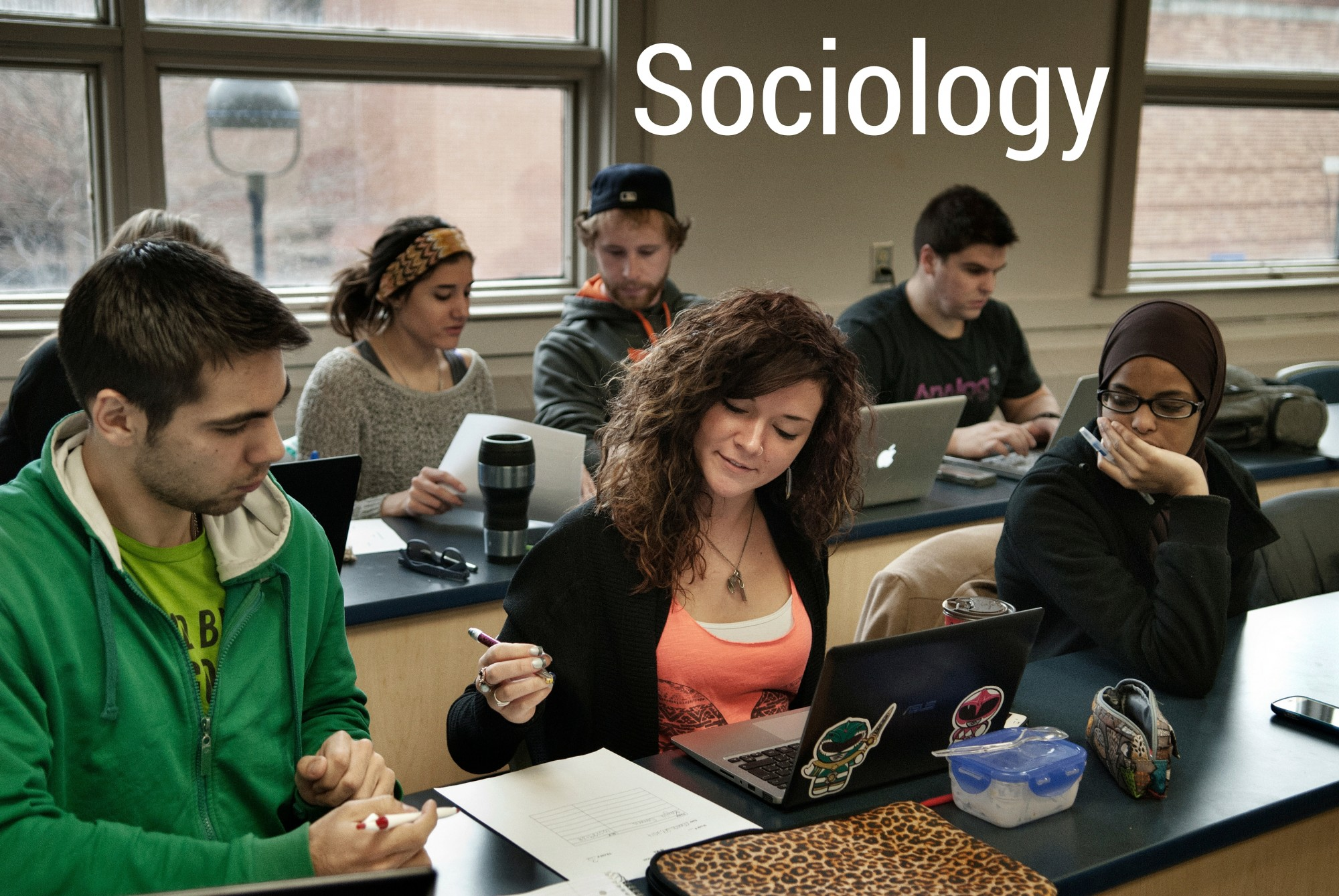 Sociology students in a classroom with Sociology text super-imposed
