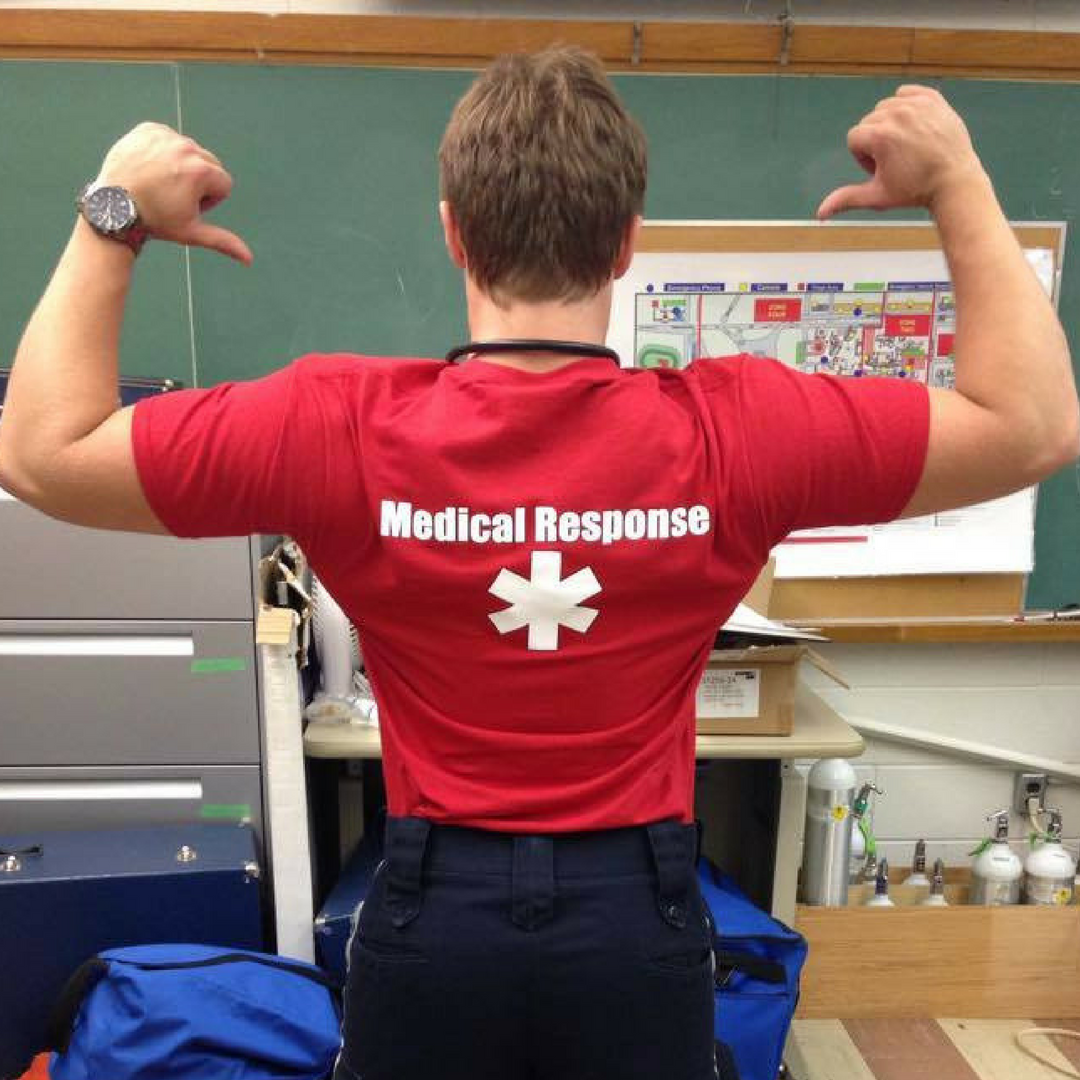 UWSMRS student showing off Medical Response shirt