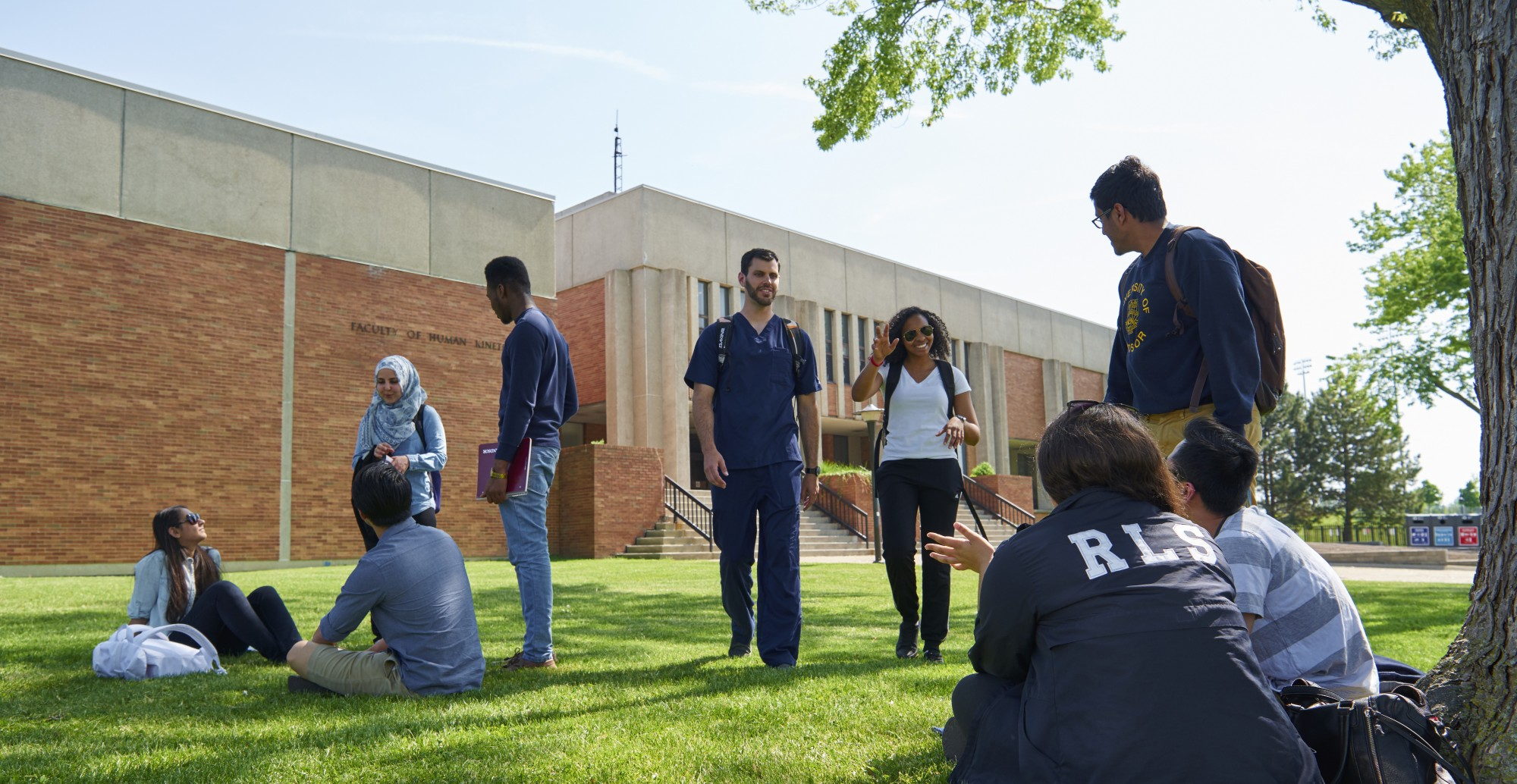 Students talking outdoors on campus grounds