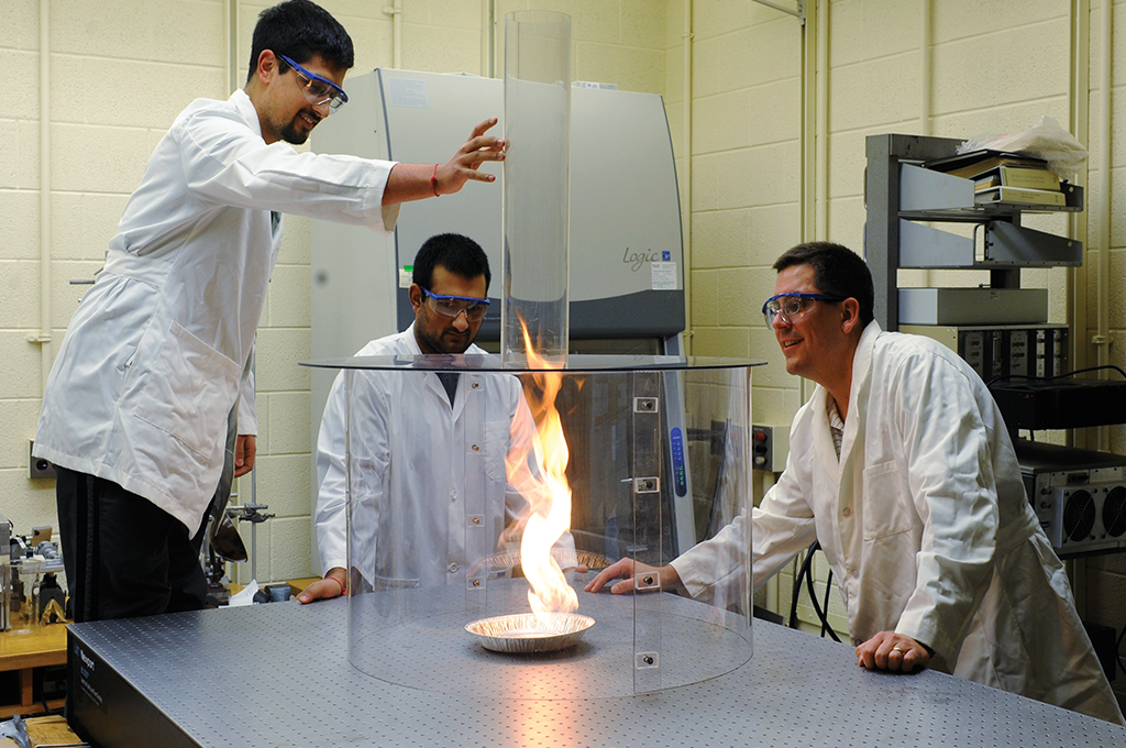 Chemistry student in lab performing experiment