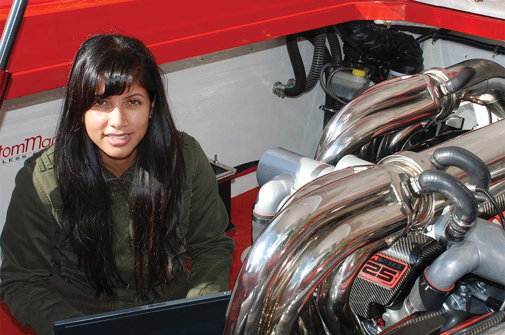 Engineering student performing tests on vehicle