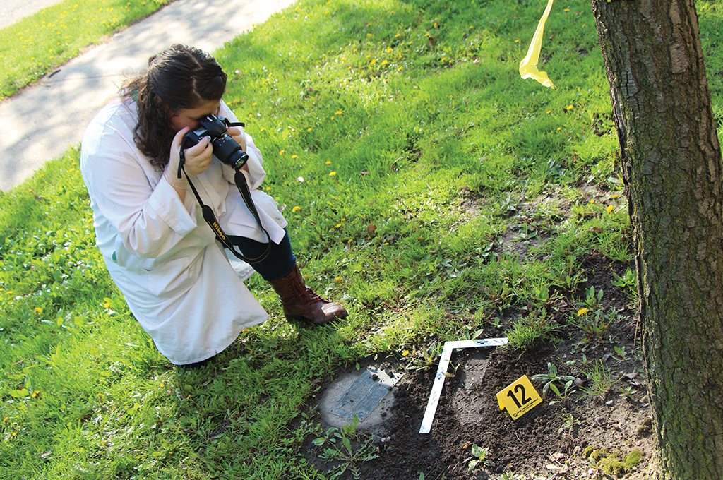 forensic student outside gathering evidence