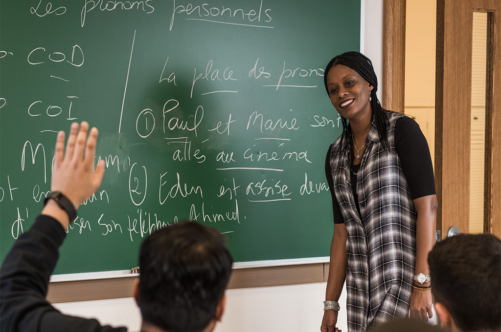 french teacher teaching students