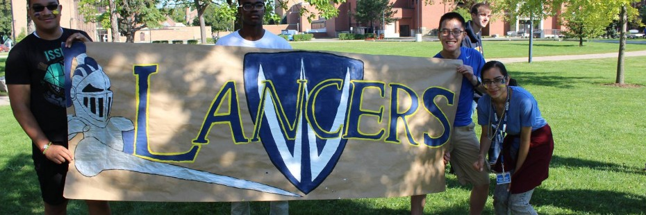 Students holding a banner that says 'Lancers'