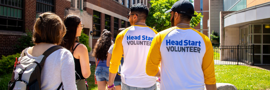 Head start volunteers talking with new students