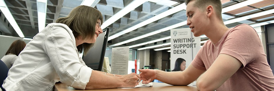 Student getting help at the writing support desk