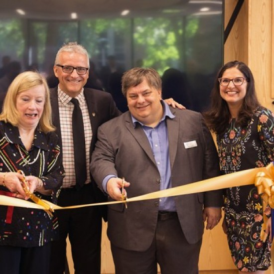 Donor Mary Hatch gets some help with ribbon cutting from UWindsor president Robert Gordon, head librarian Pascal Calarco, and associate Karen Pillon.