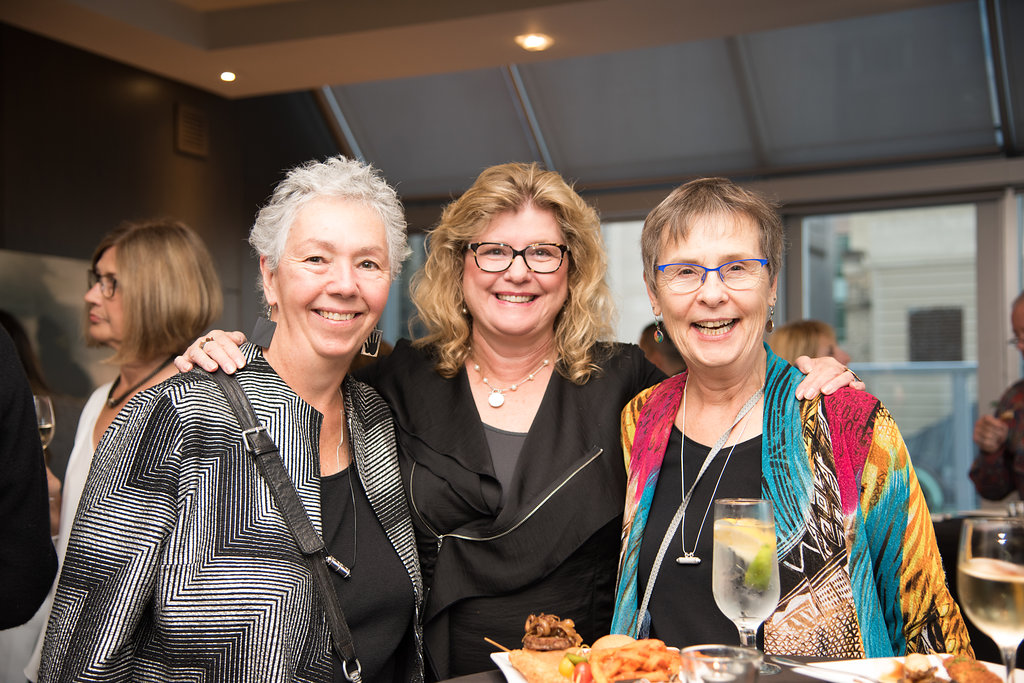 A photo of the 2017 TIFF Alumni Reception shows Nan Hudson, Gloria Smith, BA '74, and Elizabeth MacDonald, BA '74.