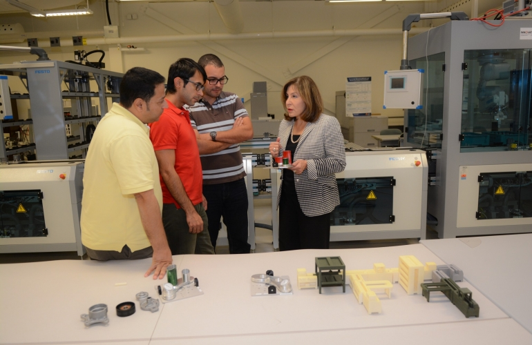 Engineering professor Hoda ElMaraghy is shown with students in the Intelligent Manufacturing Systems Centre.