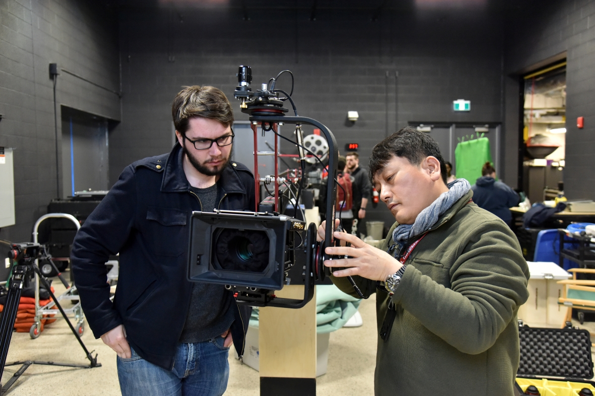 Professor Min Bae with communication studies student and camera.