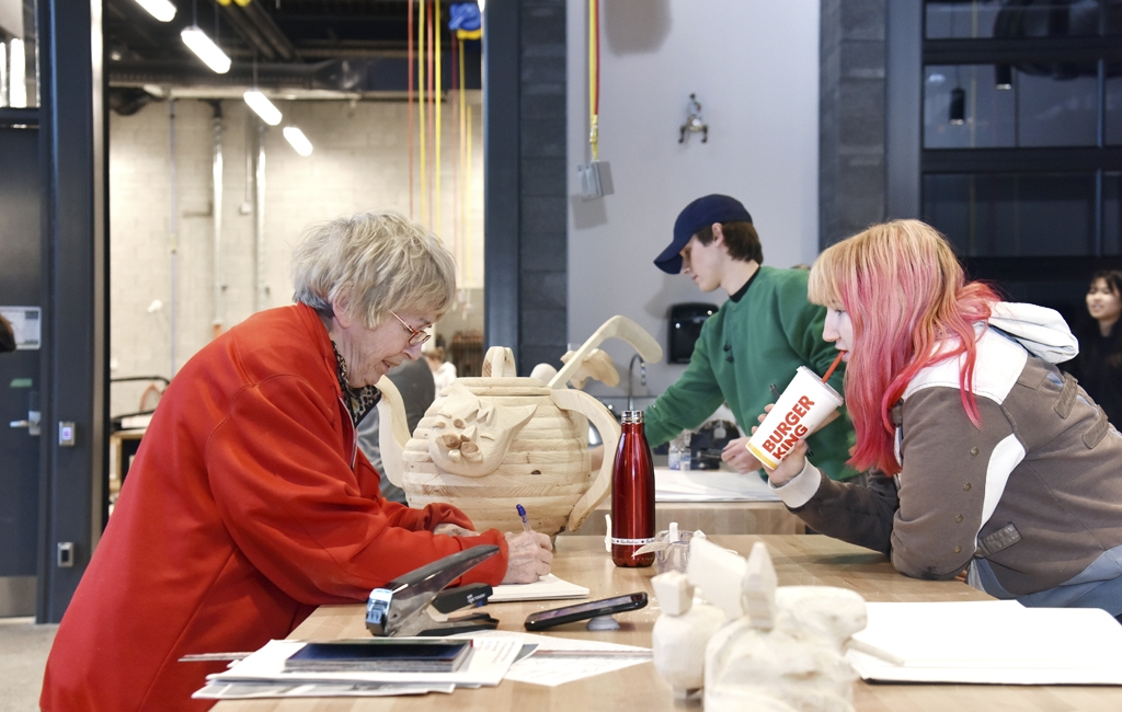 "Students work on their projects in the ""Making Studio"" in the Alan Wildeman Centre for Creative Arts. From left: Alice Sacharoff, Megan Caza"