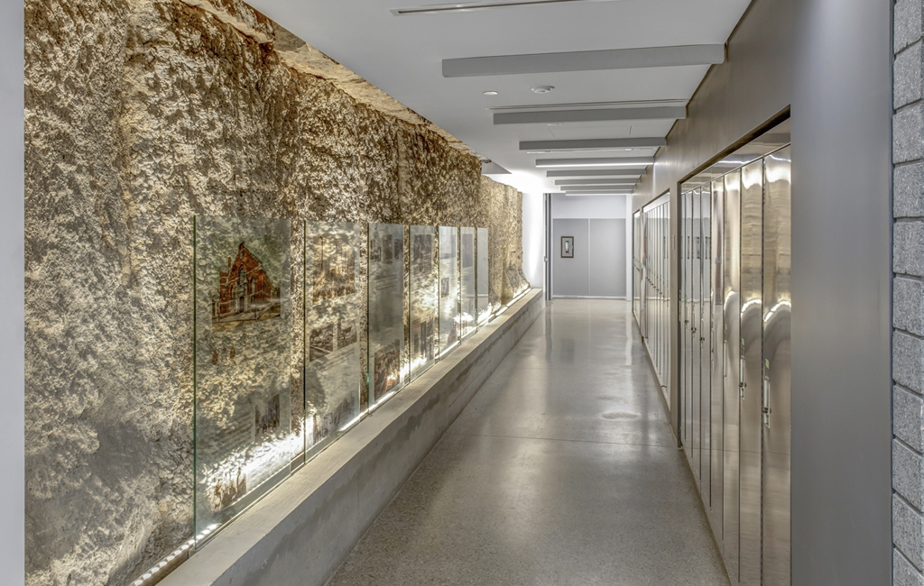 The Heritage Wall in the Armouries' basement uses glass panels to tell the building's history