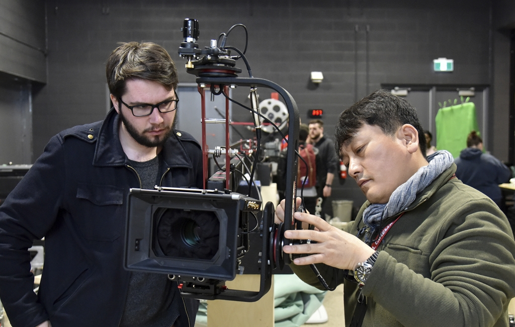 Film production Professor Min Bae (right) works with a student in his Motion Picture Technologies course