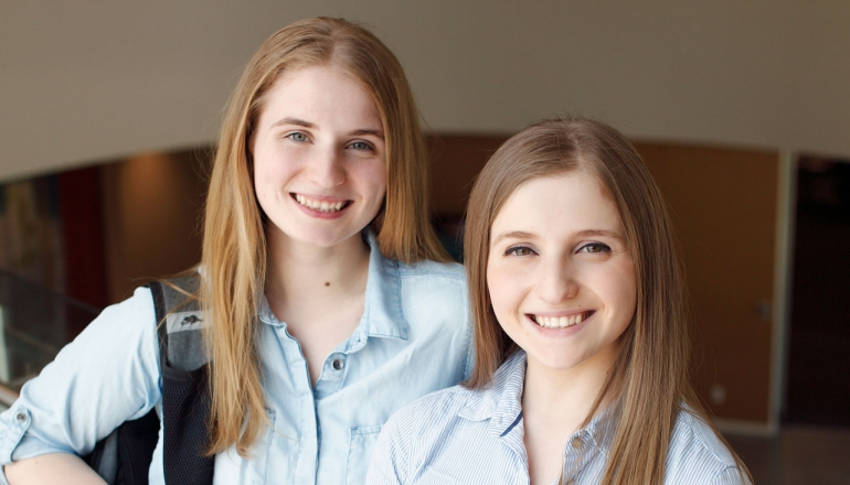 Twin sisters and UWindsor students Liza and Alexa DiCecco are shown together in the University of Windsor Welcome Centre.