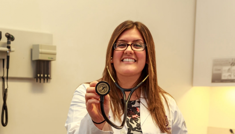 Medical student Dema Kadri is shown holding a stethoscope.