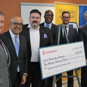 UWindsor interim president Douglas Kneale is shown with Cross-Border Institute director Bill Anderson, flank Scotiabank officials Alex Besharat, senior vice-president and head of Canadian wealth management; Terry Roman, director and market lead of commercial banking; Charles Achampong, director of academic partnership