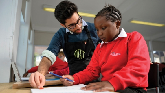 Alex Kais with a student