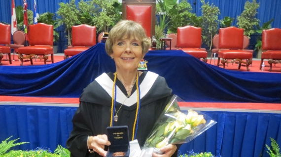 Susan Lindsay graduated with two degrees, 43 years apart.